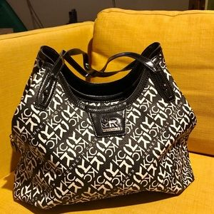 Kenneth Cole Reaction purse large and in charge